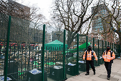 London, UK. 31 January, 2021. HS2 security guards patrol around Euston Square Gardens where climbers from the National Eviction Team (NET) are currently dismantling a camp built by anti-HS2 activists from umbrella campaign group HS2 Rebellion seeking to protect trees there from felling by HS2 Ltd in connection with the controversial HS2 high-speed rail project. Five activists continue to occupy tunnels beneath the camp, including Dan Hooper who was known as the roads protester Swampy during the 1990s.