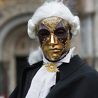 VENICE, ITALY - FEBRUARY 11:  A man wearing a Carnival costume poses for pictures in St. Mark's Square on February 11, 2012 in Venice, Italy.The annual festival, which lasts nearly three weeks, will see the streets and canals of Venice filled with people wearing highly-decorative and imaginative carnival costumes and masks.