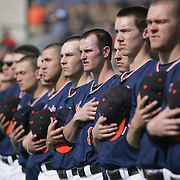 Members of The University of Virginia Baseball team observe the National Anthem before their season opener against The University of Kentucky. The university of Kentucky faced the University of Virginia in the opening game of the Hughes Brothers Challenge Friday February 14, 2014 at Brooks Field on the campus of the University of North Carolina at Wilmington in Wilmington, N.C. (Jason A. Frizzelle)