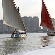 Sailing feluccas on the River Nile, a popular tourist activity in the Egyptian capital, Cairo.