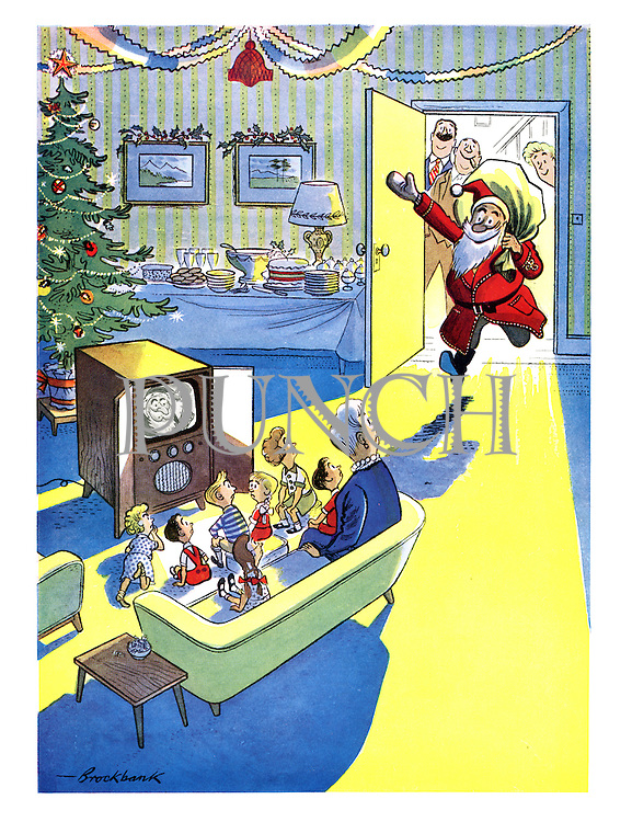 (Children are confused when Father Christmas bursts into the room while they watch him on television at the same time)