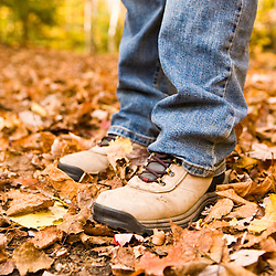 Legs and boots on the Lincoln Woods Trail in New Hampshire's White Mountain National Forest.