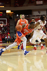 21 November 2015: Anthony Odunsi(2) looks for the lane and is matched step for step by Tony Wills(12). Illinois State Redbirds host the Houston Baptist Huskies at Redbird Arena in Normal Illinois (Photo by Alan Look)