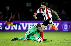 Nathan Arnold of Lincoln City rounds Dean Gerken of Ipswich Town to score the winning goal - Mandatory by-line: Robbie Stephenson/JMP - 17/01/2017 - FOOTBALL - Sincil Bank Stadium - Lincoln, England - Lincoln City v Ipswich Town - Emirates FA Cup third round replay