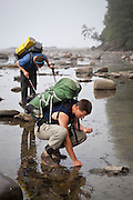 Henry (front) and Zach Podell-Eberhardt search tide pools for life near Bonilla Point, West Coast Trail, British Columbia, Canada.