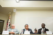 Contestants pass the microphone between responses during the Milpitas Unified School District Board of Education forum at the Barbara Lee Senior Center in Milpitas, California, on October 2, 2014. (Stan Olszewski/SOSKIphoto)