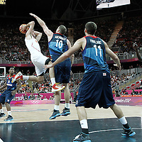 02 August 2012: Spain Rudy Fernandez looks to pass the ball in the air over Great Britain Robert Archibald during 79-78 Team Spain victory over Team Great Britain, during the men's basketball preliminary, at the Basketball Arena, in London, Great Britain.