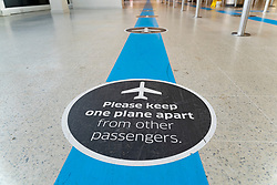 Edinburgh, Scotland, UK. 15 Feb 2021. From today Scottish Government requires all passengers from overseas arriving at Scottish airports to go into a mandatory quarantine in a hotel. Pic; Social distancing sign on floor of terminal. Iain Masterton/Alamy Live news