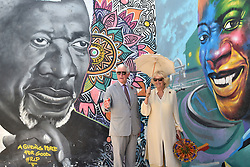 The Prince of Wales and Duchess of Cornwall stand in front of a mural of Kofi Annan during a visit to the Jamestown Cafe in Accra, Ghana, on day four of their trip to west Africa.