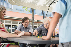 Multi-generation family playing board game, Bavaria, Germany