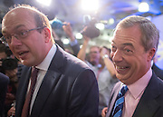 © Licensed to London News Pictures. 27/09/2014. Doncaster, UK. Nigel Farage and MP for Rochester and Strood Mark Reckless who announced his defection to UKIP from the Conservative Party at the conference today. The UKIP conference at Doncaster Racecourse Friday 27th September 2014. Photo credit : Stephen Simpson/LNP