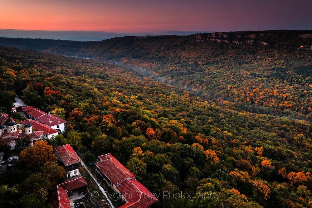 Monastery above an autumn forest