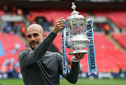 Manchester City manager Pep Guardiola lifts the trophy - Mandatory by-line: Arron Gent/JMP - 18/05/2019 - FOOTBALL - Wembley Stadium - London, England - Manchester City v Watford - Emirates FA Cup Final