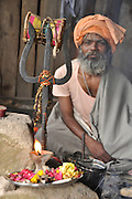 Holy man with trident in Udaipur, Rajasthan, India