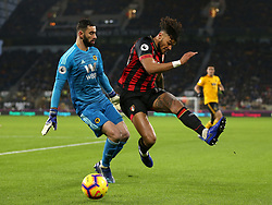 Wolverhampton Wanderers goalkeeper Rui Patricio (left) and Bournemouth's Tyrone Mings battle for the ball