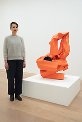 © Licensed to London News Pictures. 07/06/2018. London, UK. Artist CAROL BOVE poses next to her work titled Rich Mom, 2018 (R) showing as part of an exhibition at the David Zwirner gallery. Photo credit: Ray Tang/LNP