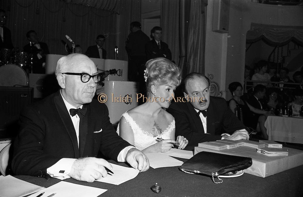 28/04/1965<br /> 04/28/1965<br /> 28 April 1965<br /> Festival of Kerry Dublin Ball at the Gresham Hotel, Dublin. Photo shows (l-r): JudgesTommy Hennigan; Frances McDermott and Donal O'Morain.
