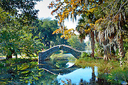 The Langles Bridge, built in 1902, is an old stone bridge that crosses a preserved bayou  in City Park, one of the United States oldest urban parks in New Orleans. The park holds the world's largest collection of mature live oaks.