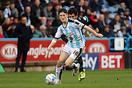 Joe Lolley of Huddersfield Town gets in front of Alex Lopez of Sheffield Wednesday. Skybet football league Championship match, Huddersfield Town v Sheffield Wednesday at the John Smith's Stadium in Huddersfield, Yorkshire on Saturday 2nd April 2016.<br /> pic by Chris Stading, Andrew Orchard sports photography.