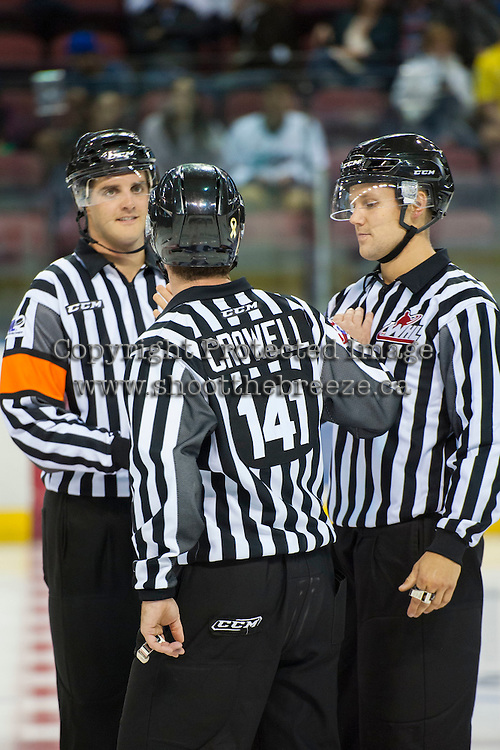 KELOWNA, CANADA - SEPTEMBER 5: Steve Papp, referee, Dustin Minty, Linesman and Kevin Crowell, Linesman stand at centre ice on September 5, 2015 during the first pre-season game at Prospera Place in Kelowna, British Columbia, Canada.  (Photo by Marissa Baecker/Shoot the Breeze)  *** Local Caption *** Dustin Minty; Steve Papp, Kevin Crowell;