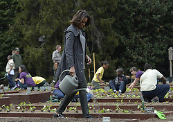 61337997<br /> U.S. First Lady Michelle Obama plants with school children in the White House Kitchen Garden on the South Lawn of the White House in Washington D.C., capital of the United States, April 2, 2014. U.S. First Lady Michelle Obama joined FoodCorps leaders and local students to plant the White House Kitchen Garden for the sixth year in a row, USA,  Wednesday, 2nd April 2014. Picture by  imago / i-Images<br /> UK ONLY