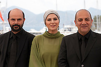 Actor Ali Mosaffa, actress Sahar Dolatshahi and director Behnam Behzadi at the Inversion film photo call at the 69th Cannes Film Festival Wednesday 18th May 2016, Cannes, France. Photography: Doreen Kennedy