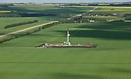 Photo Randy Vanderveen.Grande Prairie, Alberta. .A drilling rig works in a field north of Grande Prairie.
