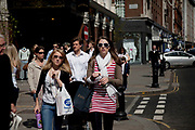 Woman out shopping on the Kings Road, Chelsea. London