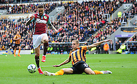 Burnley's Danny Ings is tackled by Hull City's Michael Dawson<br /> <br /> Photographer: Chris Vaughan/CameraSport<br /> <br /> Football - Barclays Premiership - Hull City v Burnley - Saturday 9th May 2015 - Kingston Communications Stadium - Hull<br /> <br /> © CameraSport - 43 Linden Ave. Countesthorpe. Leicester. England. LE8 5PG - Tel: +44 (0) 116 277 4147 - admin@camerasport.com - www.camerasport.com