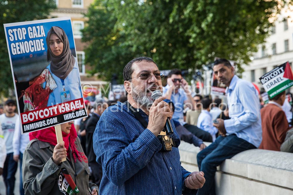 London, UK. 10th June, 2018. Massoud Shadjareh, Chairman of the Islamic Human Rights Commission, addresses hundreds of people who took part in the pro-Palestinian Al Quds Day march through central London. An international event, it began in Iran in 1979. Quds is the Arabic name for Jerusalem.