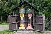A landscape of two sweets confectionary dispensers on a residential street, on 16th September 2019, in Zakopane, Malopolska, Poland.