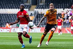 Benik Afobe of Bristol City takes on Jordy de Wijs of Hull City - Mandatory by-line: Robbie Stephenson/JMP - 24/08/2019 - FOOTBALL - KCOM Stadium - Hull, England - Hull City v Bristol City - Sky Bet Championship