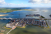 Nederland, Noord-Holland, Amsterdam, Stadsdeel Zeeburg, 16-04-2012; overzicht van IJburg, het Steigereiland (met drijvende huizen) met midden rechts de Waterbuurt met drijvende  woningen en de Enneus Heermabrug. In de achtergrond Buiten-IJ met strekdam, de kust van Waterland met Durgerdam. .Overview of IJburg, the new urban development district of Amsterdam, the Steigereiland (floating houses)  and Enneus Heerma Bridge. In the background Buiten-IJ and breakwater, the coast of Waterland with Durgerdam..luchtfoto (toeslag), aerial photo (additional fee required);.copyright foto/photo Siebe Swa