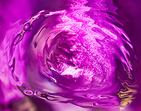 abstract violet vortex with white shades on violet blurred background