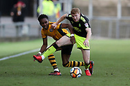 Shaun McCoulsky of Newport County is challenged by Brad Halliday of Cambridge Utd (r). The Emirates FA Cup, 2nd round match, Newport County v Cambridge United at Rodney Parade in Newport, South Wales on Sunday 3rd December 2017.<br /> pic by Andrew Orchard,  Andrew Orchard sports photography.