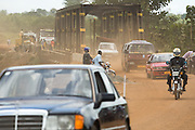 Traffic crosses a bridge intended for trains opened to road traffic to replace a  bridge that collapsed due to heavy rains near Notse, Togo on Friday September 11, 2009.