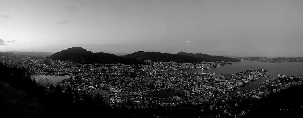 Moon Over Bergen Norway at Dawn from Mount Fløyen. Image taken with a Leica X2 camera (ISO 400, 24 mm, f/2.8, 1/60 sec). In camera B&W. Composite panorama of 9 vertical images using PTGui Pro 9.