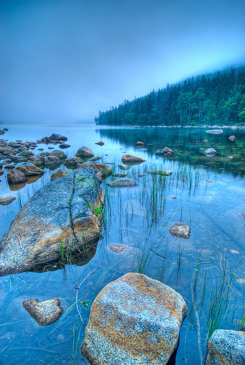 Jordan Pond, Acadia NP, Maine.<br /> Eight days of overcast,alternating heavy rains and fog made up this nine day trip.  At some point you are thinking enough (even though photographers love those conditions, there comes a point...).  Hoping for a sunset this evening, I waited at Jordan Pond, but instead the clouds thickened and rolled down from the peaks above while the late sun tried valiantly to burn them off.  It didn't, but it was a nice mood.  This an HDR rendition.