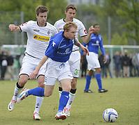 BILDET INNGÅR IKKE I FASTAVTALENE PÅ NETT MEN MÅ KJØPES SEPARAT<br /> <br /> Fotball<br /> Tyskland<br /> Foto: imago/Digitalsport<br /> NORWAY ONLY<br /> <br /> 21.07.2012  <br /> Borussia Mönchengladbach vs FC Birmingham City, Testspiel Håvard Nordtveit (Borussia Moenchengladbach), Branimir Hrgota (Borussia Moenchengladbach) Chris Burke, (Birmingham City) v.li.