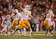 Nov 12, 2011; Fayetteville, AR, USA;  Tennessee Volunteers quarterback Justin Worley (14) throws under pressure as offensive linemen Dallas Thomas (71) and Marcus Jackson (68) block during a game against the Arkansas Razorbacks at Donald W. Reynolds Razorback Stadium. Arkansas defeated Tennessee 49-7. Mandatory Credit: Beth Hall-US PRESSWIRE