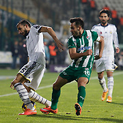 Bursaspor's Volkan Sen (R) and Fenerbahce's Mehmet Topal (L) during the Turkish soccer super league match Bursaspor between Fenerbahce at the Ataturk Stadium in Bursa Turkey on Monday, 24 November 2014. Photo by Aykut AKICI/TURKPIX