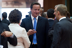 David Cameron, the U.K.'s prime minister, center, speaks with colleagues during the European Summit meeting at EU Council headquarters in Brussels, Belgium, on Thursday, June 17, 2010. (Photo © Jock Fistick)