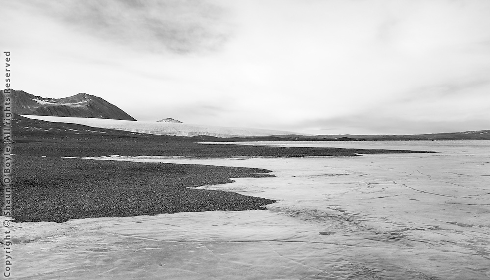 Looking east from Lake Fryxell camp toward the Commonwealth Glacier. New Harbor and McMurdo Sound is beyond Coral Ridge in the distance.