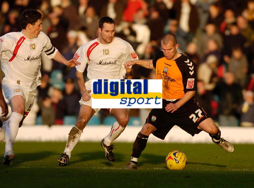 Photo: Leigh Quinnell.<br /> Milton Keynes Dons v Barnet. Coca Cola League 2. 20/01/2007. Barnets Adam Birchall holds off MK Dons Scott Taylor.