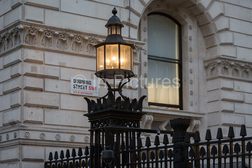 As Prime Minister Theresa May negotiates Brexit issues and members of her own Conservative government continue to resign in response to her presentation of the current terms, the light on Downing Streets reinforced security railings shines onto the walls of Whitehall, on 15th November 2018, in London, England.