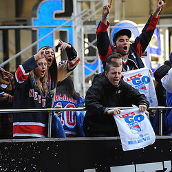April 12, 2012:  Fans cheer from a team sponsored bus tour before game 1 of the NHL Eastern Conference Quarter-finals between the Ottawa Senators and New York Rangers at Madison Square Garden in New York, N.Y.