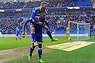 Cardiff City's Kenneth Zohore © celebrates after he scores his teams 5th goal with team mate Aron Gunnarsson (on his back). EFL Skybet championship match, Cardiff city v Rotherham Utd at the Cardiff city stadium in Cardiff, South Wales on Saturday 18th February 2017.<br /> pic by Carl Robertson, Andrew Orchard sports photography.