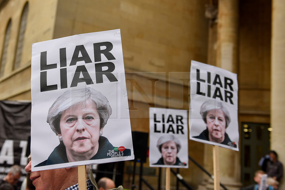 """© Licensed to London News Pictures. 02/06/2017. London, UK. Demonstrators gather outside the BBC headquarters in protest against the Corporation for not playing the song """"Liar Liar"""" by Captain Ska on BBC Radio 1.  Organised by The People's Alliance, people carried signs bearing an image of Prime Minister Theresa May with the words """"Liar Liar"""" and """"You Can't Trust Her"""" on each side.   Photo credit : Stephen Chung/LNP"""