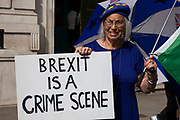 Anti Brexit protesters waving European Union flags and one with a Brexit is a crime scene placard outside the Cabinet Office in Westminster as it is announced that Boris Johnson has had his request to suspend Parliament approved by the Queen on 28th August 2019 in London, England, United Kingdom. The announcement of a suspension of Parliament for approximately five weeks ahead of Brexit has enraged Remain supporters who suggest this is a sinister plan to stop the debate concerning a potential No Deal.