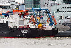 © Licensed to London News Pictures. 07/10/2015. London, UK. RRS Discovery, the National Oceanography Centre Royal Research Ship arrives in London this morning and moors next to HMS Belfast in front of Tower Bridge on the River Thames. RRS Discovery is making a rare London visit for a series of events to celebrate 50 years of the Natural Environment Research Council. Photo credit : Vickie Flores/LNP